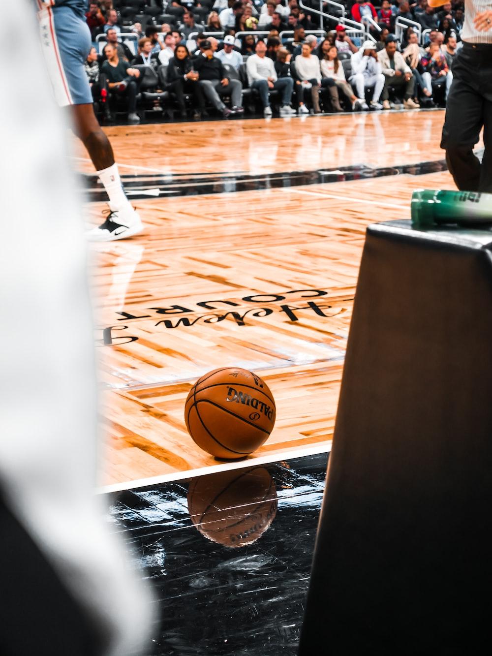 brown basketball on brown wooden floor