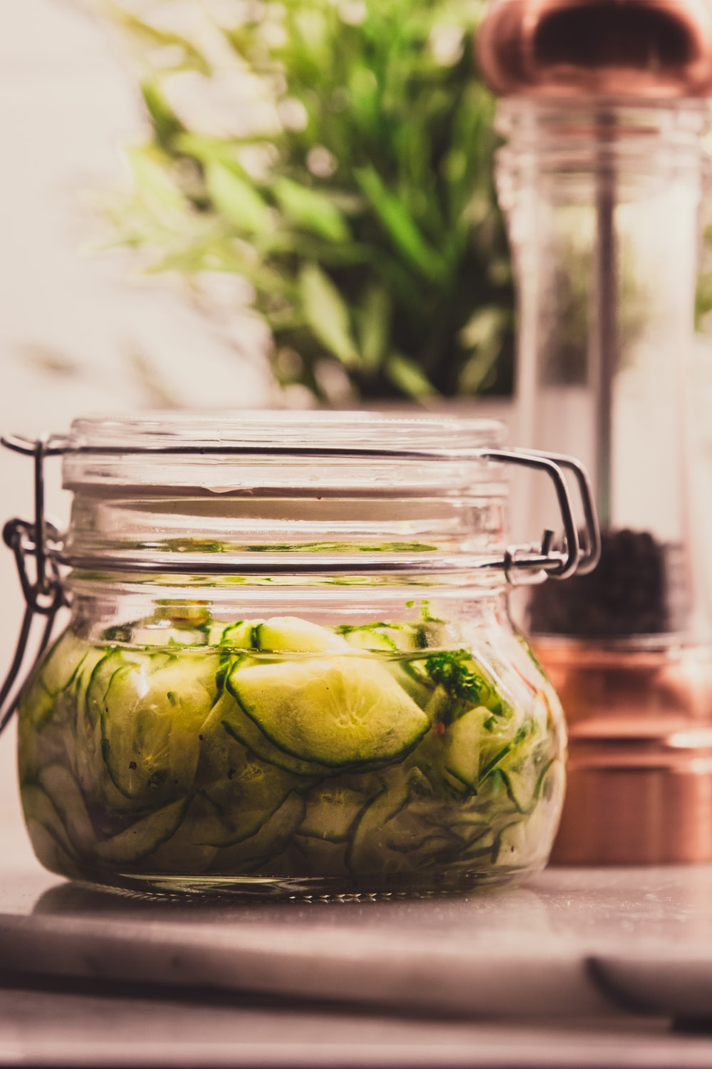 clear glass jar with green fruit inside