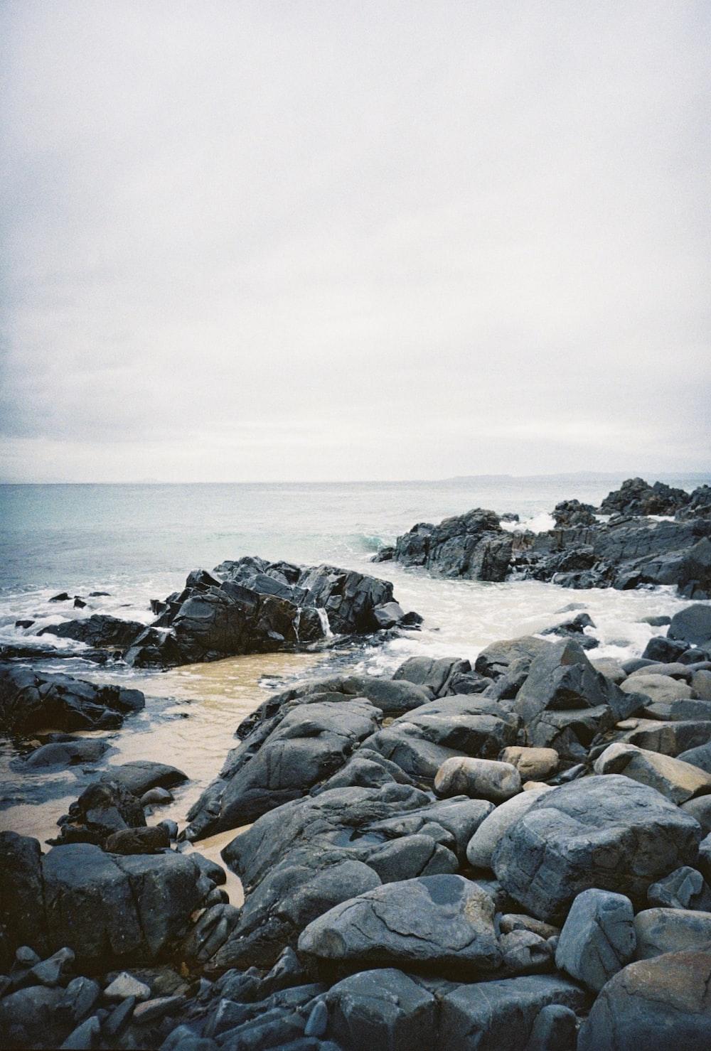 gray rocky shore under gray sky