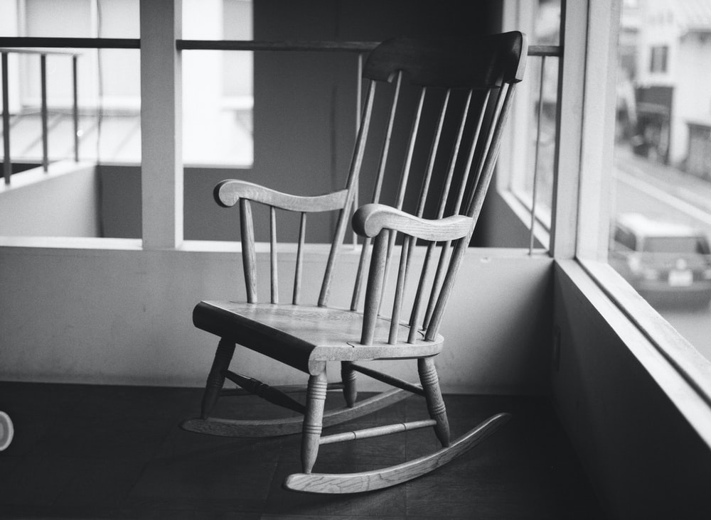 grayscale photo of rocking chair