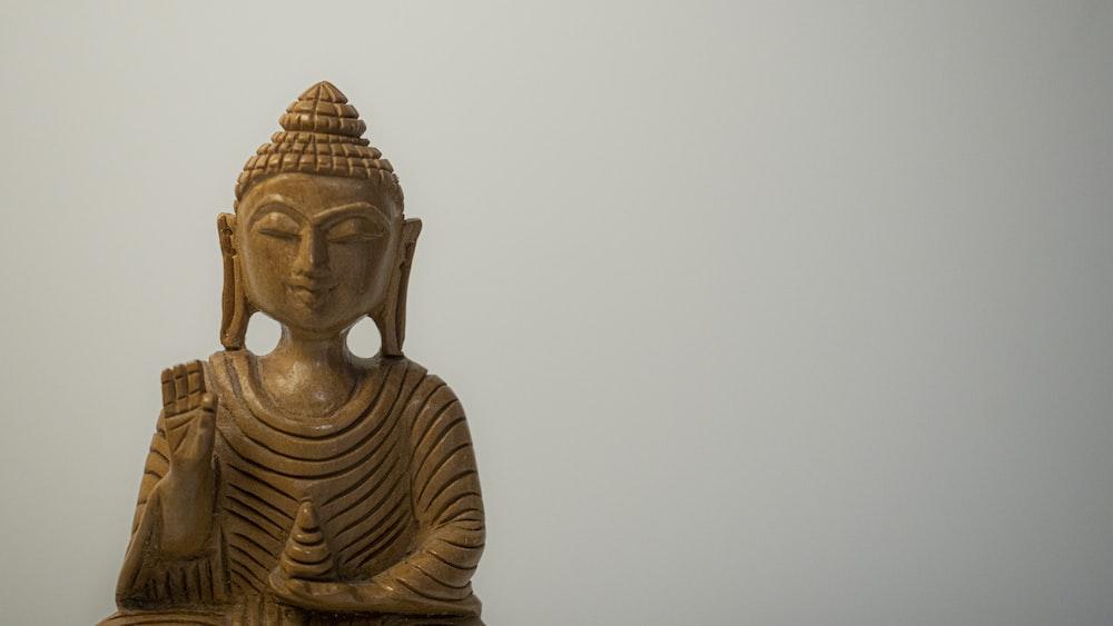 gold buddha statue during daytime