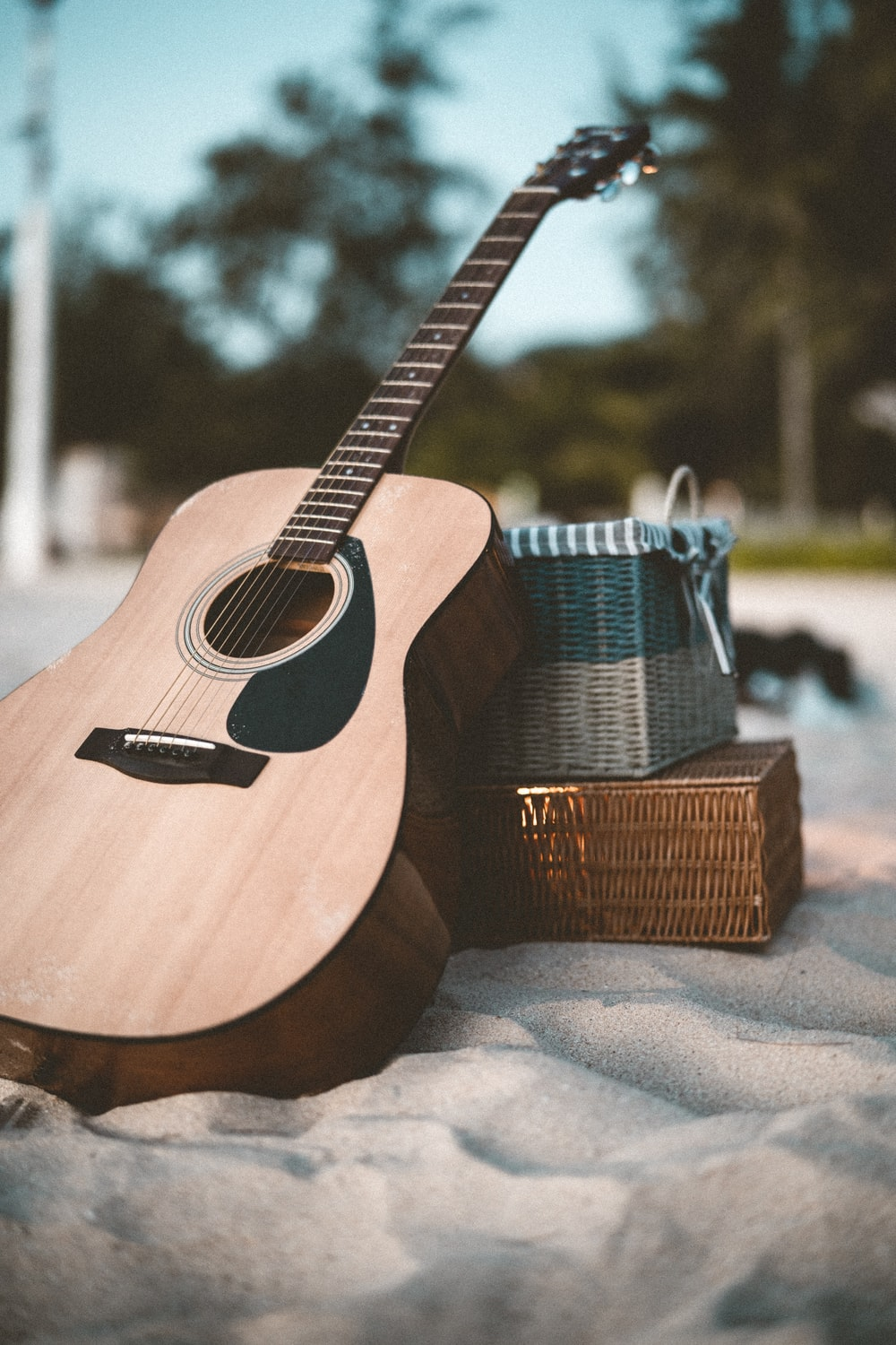 brown acoustic guitar on brown wooden table