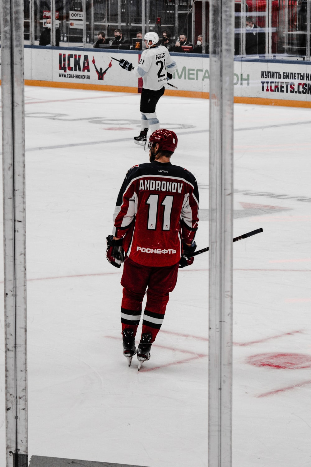 man in red and white ice hockey jersey