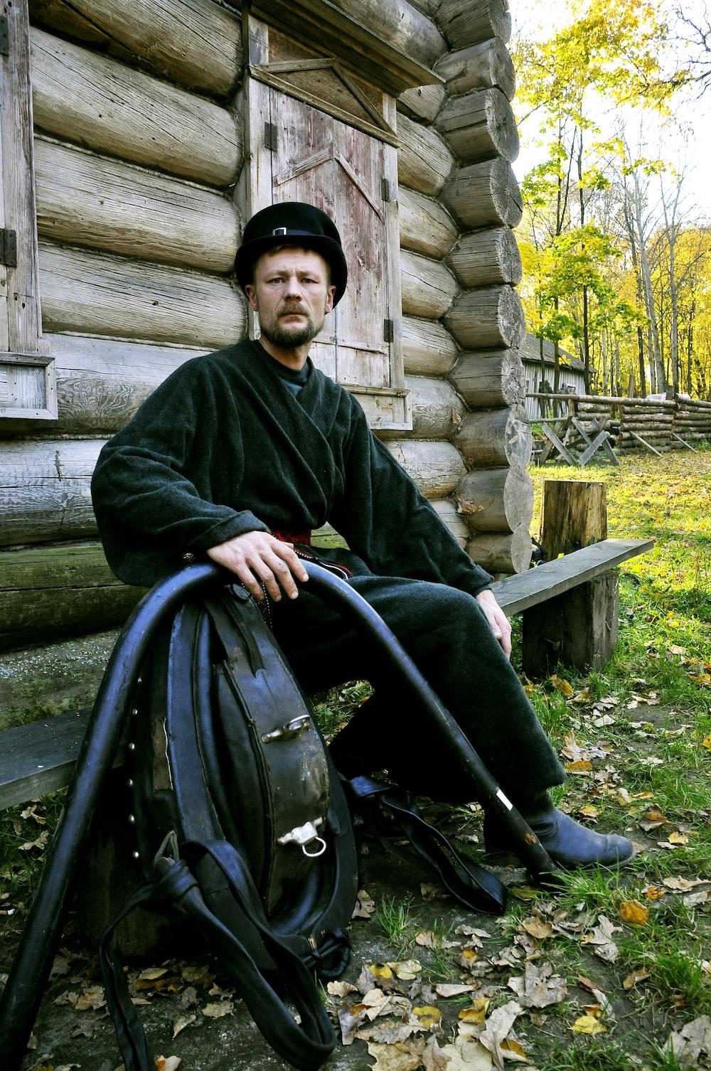 man in black jacket sitting on black wheel chair
