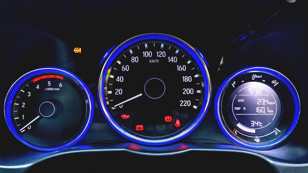 black and blue car speedometer