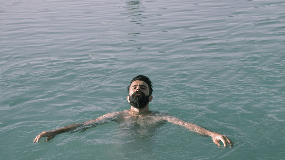 man in water during daytime