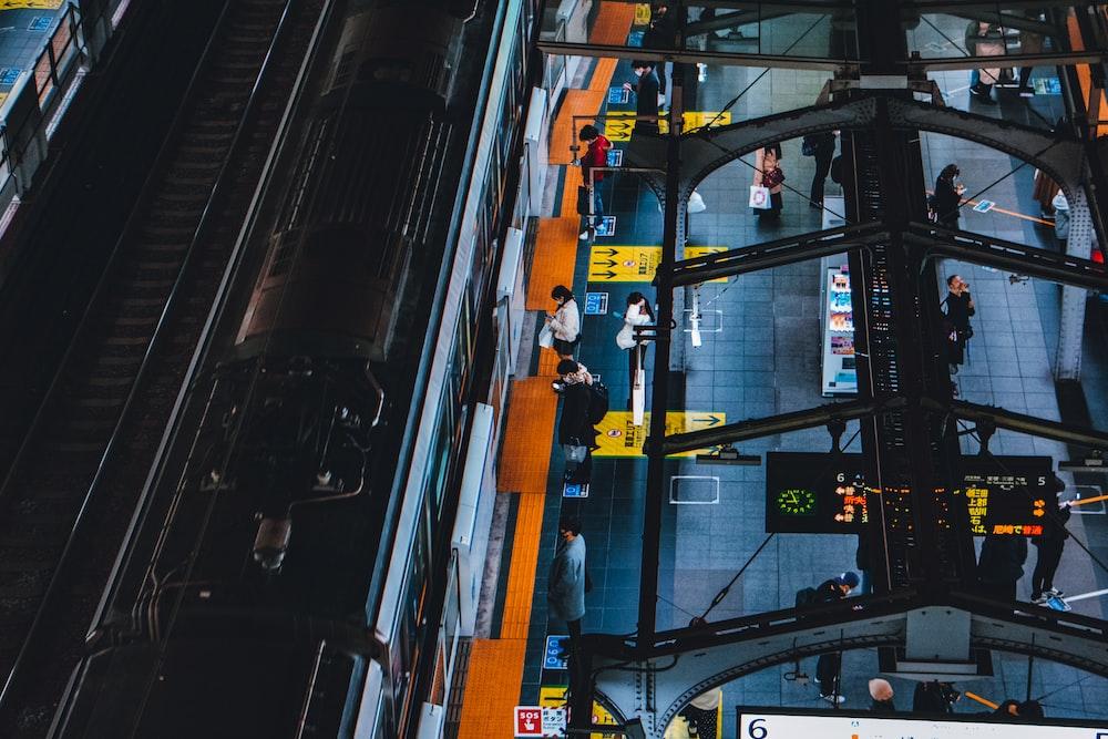 black and orange train in a city