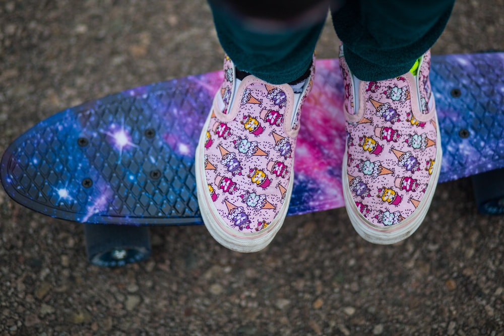person wearing pink and white floral shoes