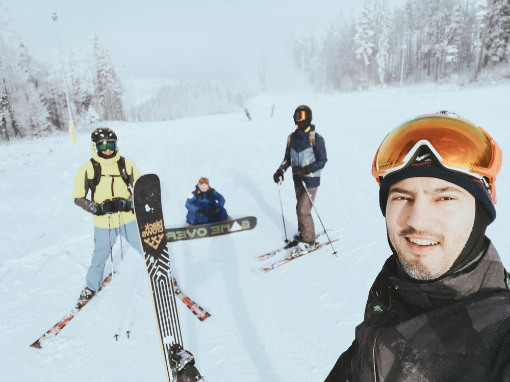 people in snow ski suit and snow ski blades