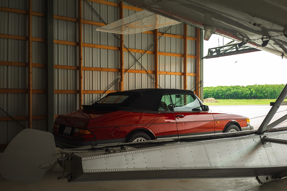 red convertible car on a trailer