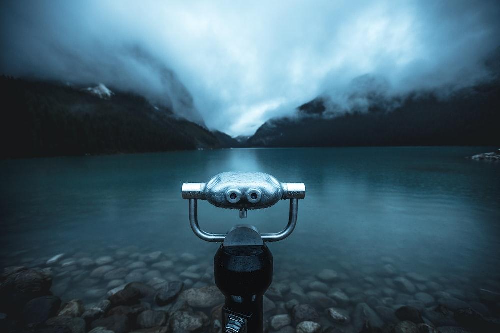 black binoculars on body of water
