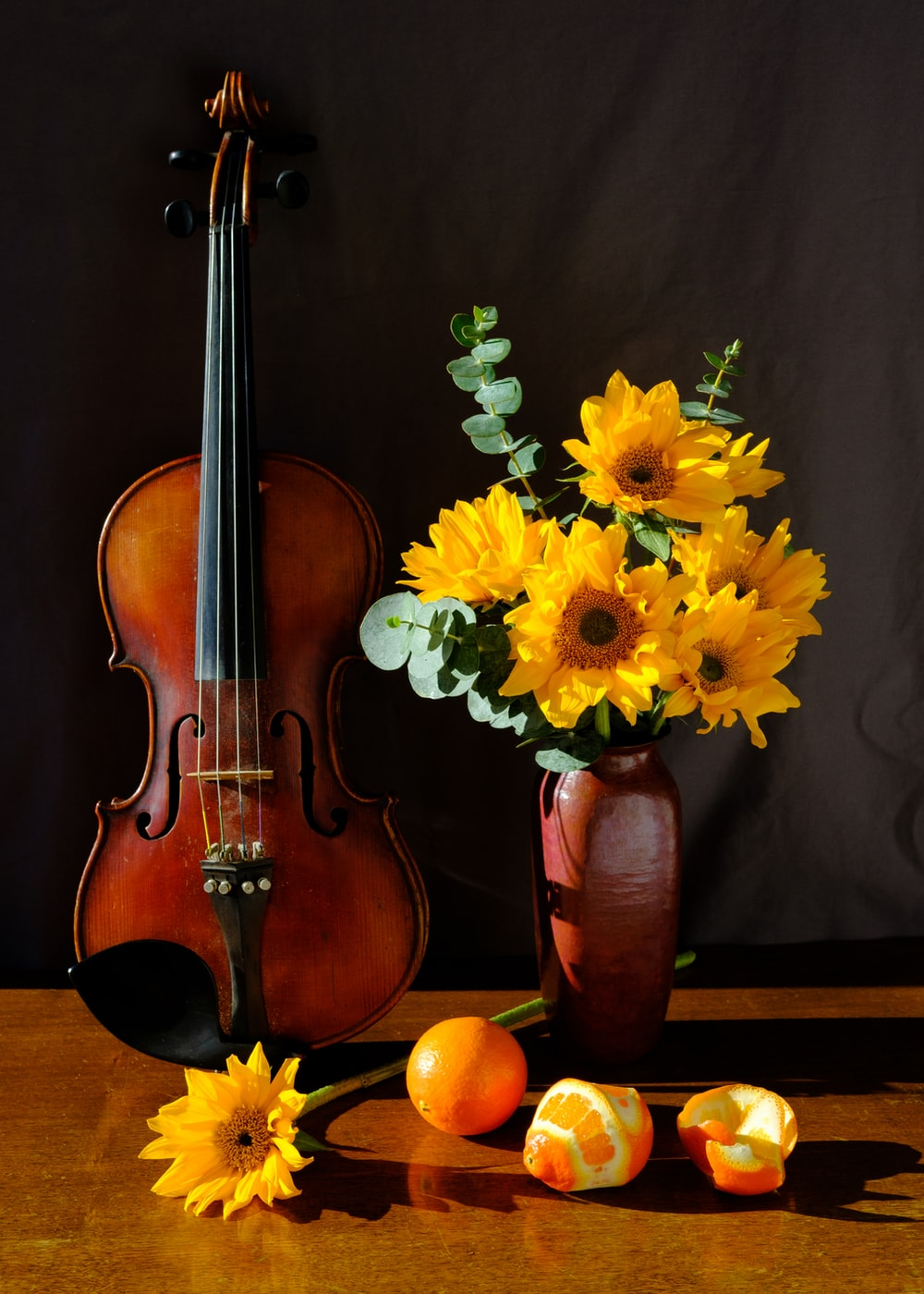 yellow and green flowers on brown violin