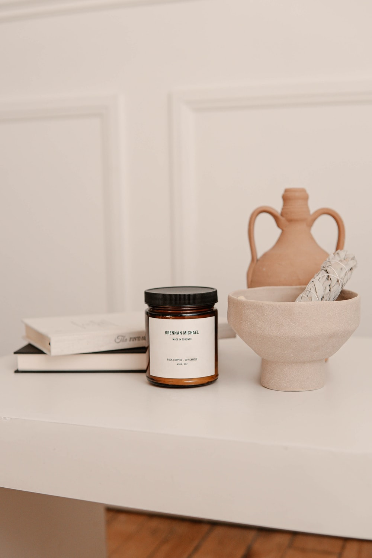 white ceramic jar on white table