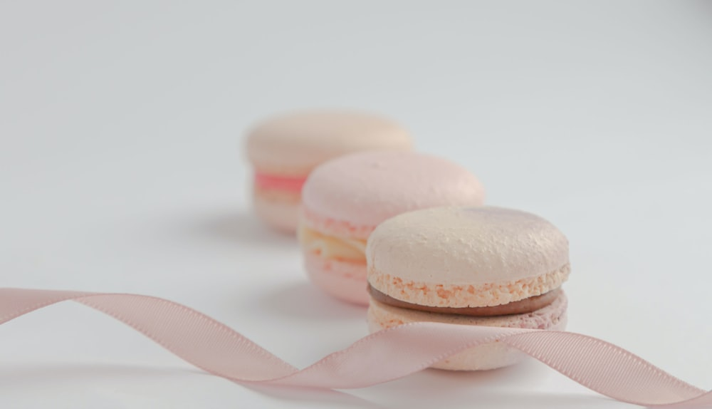 white and pink macaroons on white surface