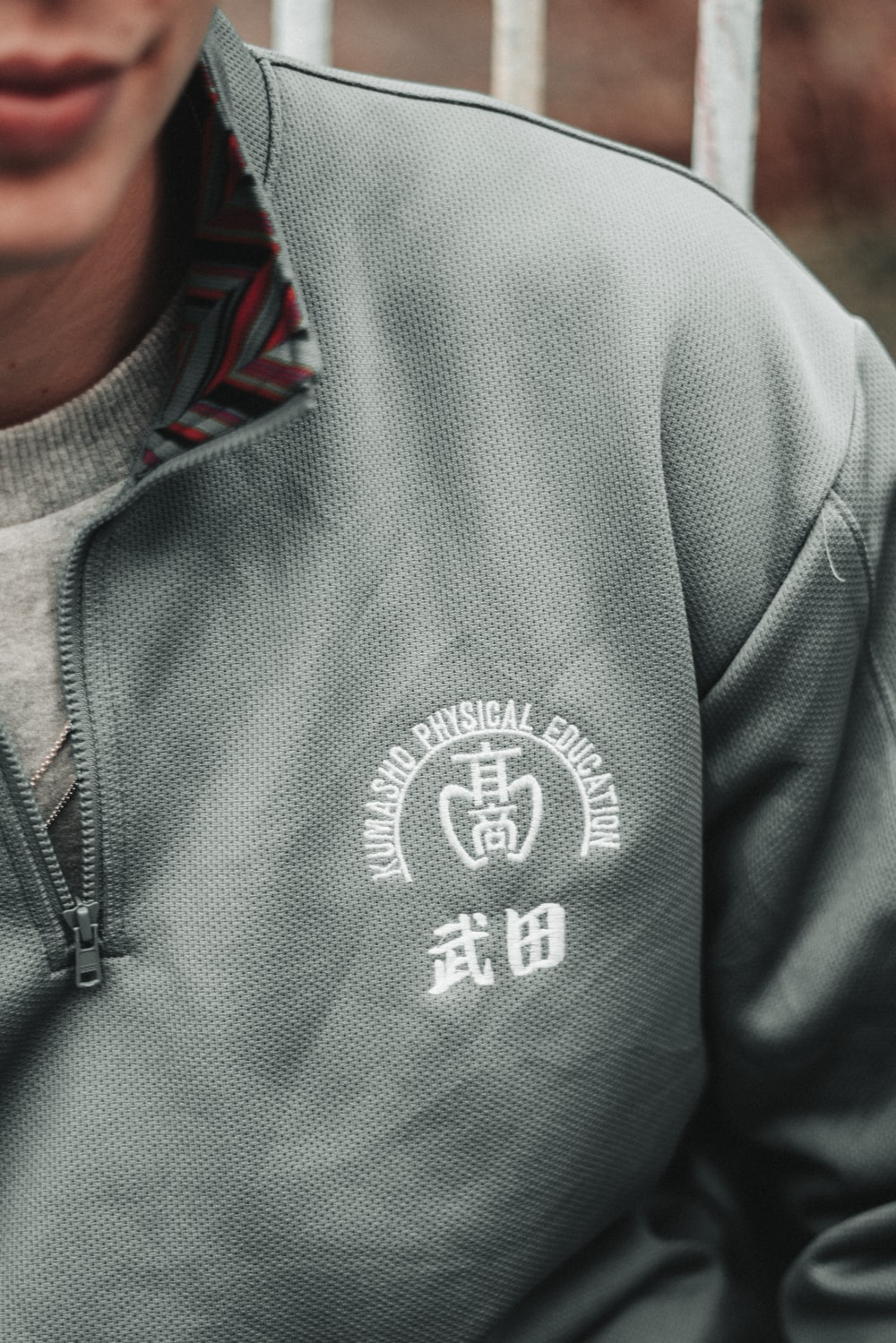 man in gray zip up hoodie
