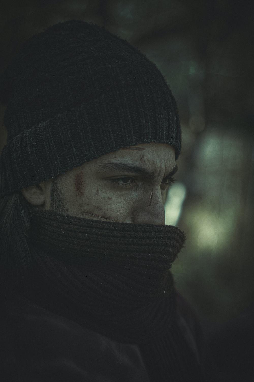 man in black knit cap