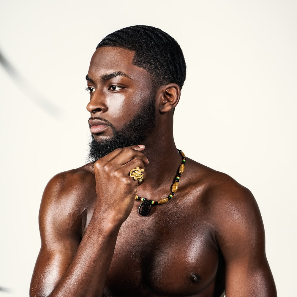 topless man with gold necklace
