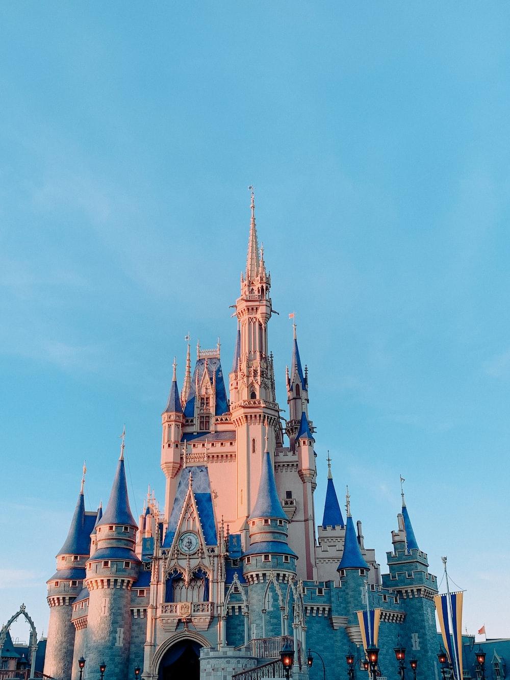 disney castle under blue sky during daytime