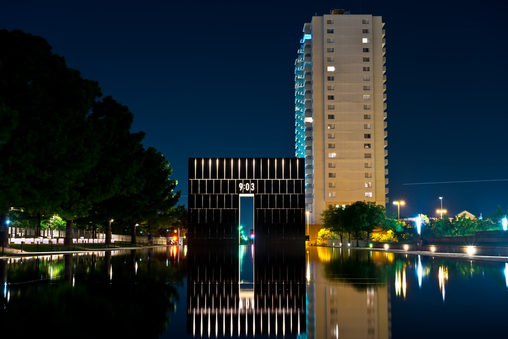 high rise building near body of water during night time