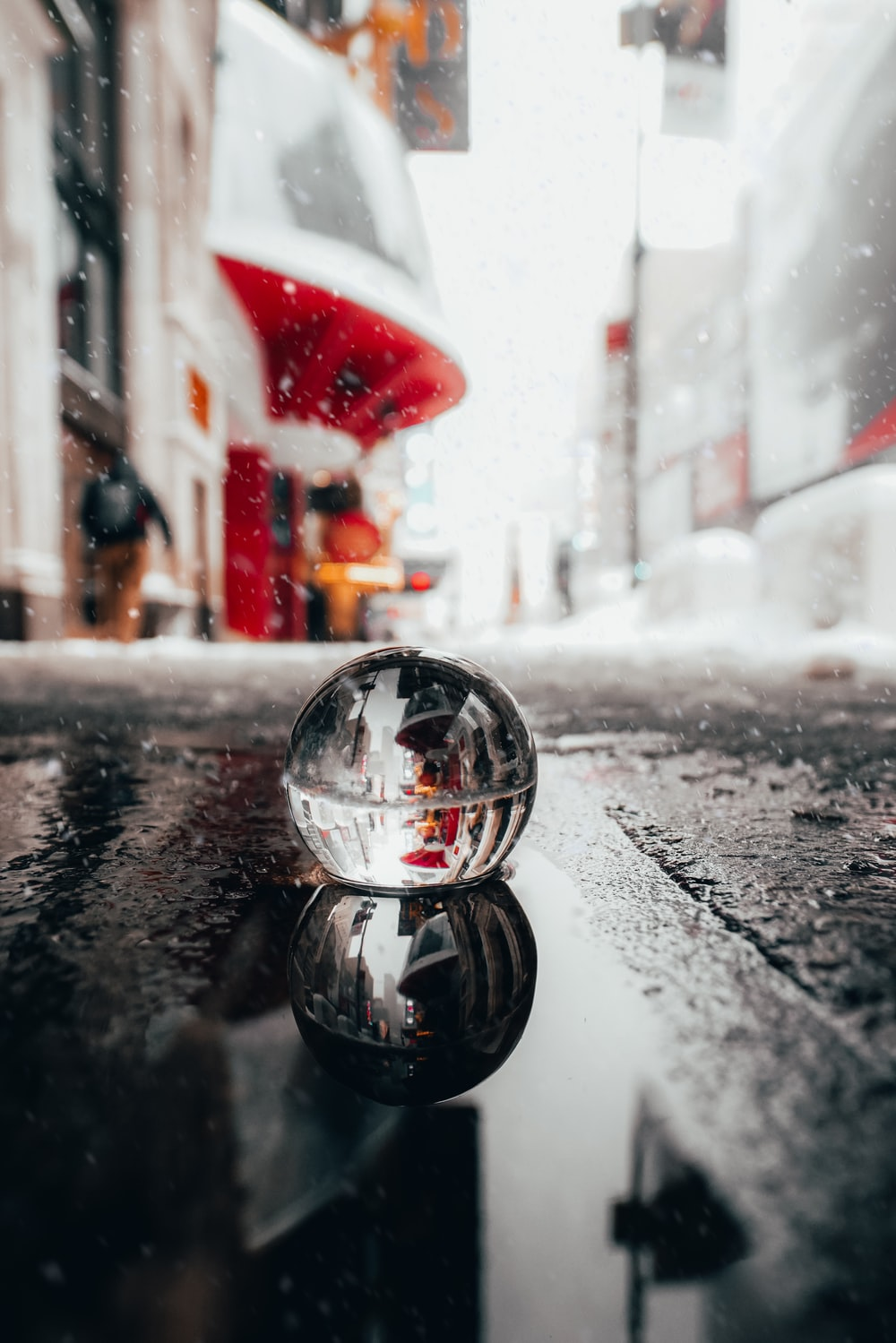 silver ball on black and white marble table