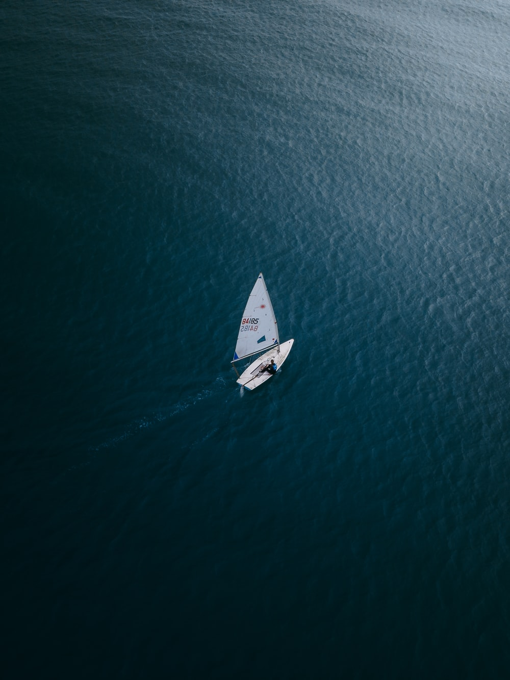 white boat on blue sea during daytime