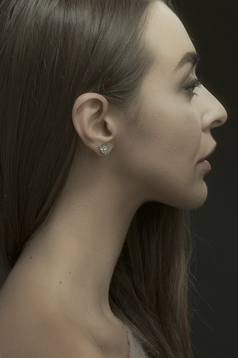 woman with silver stud earring