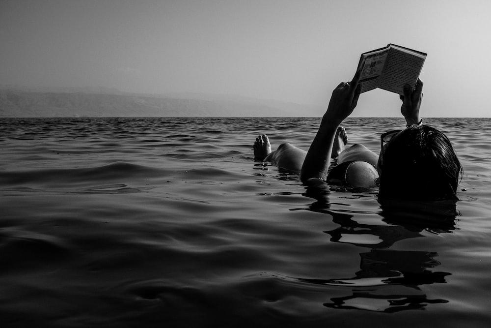 woman in bikini lying on the beach