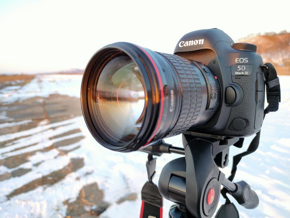black nikon dslr camera on black tripod