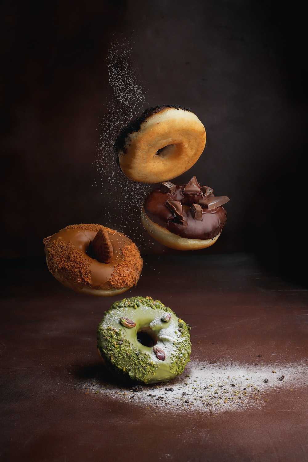 two doughnuts on brown wooden table