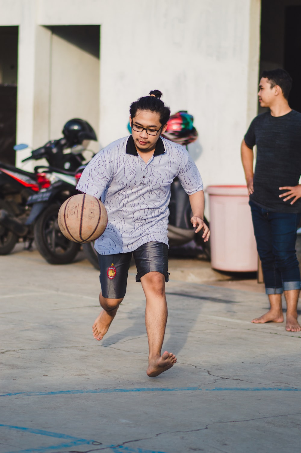 man in black and white crew neck t-shirt holding basketball