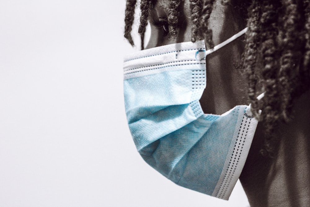blue and white textile on white textile