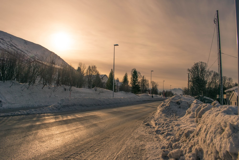 snow covered road during daytime