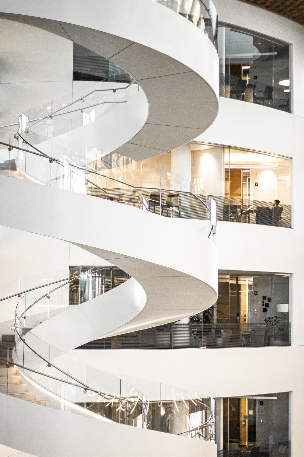 white spiral staircase with glass windows