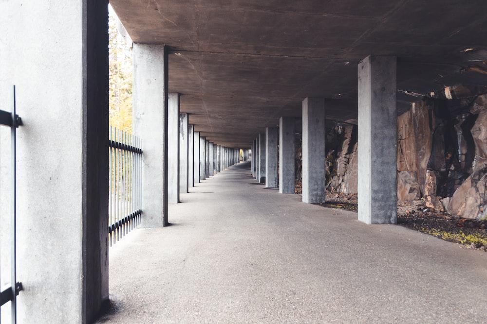brown wooden hallway with black metal railings