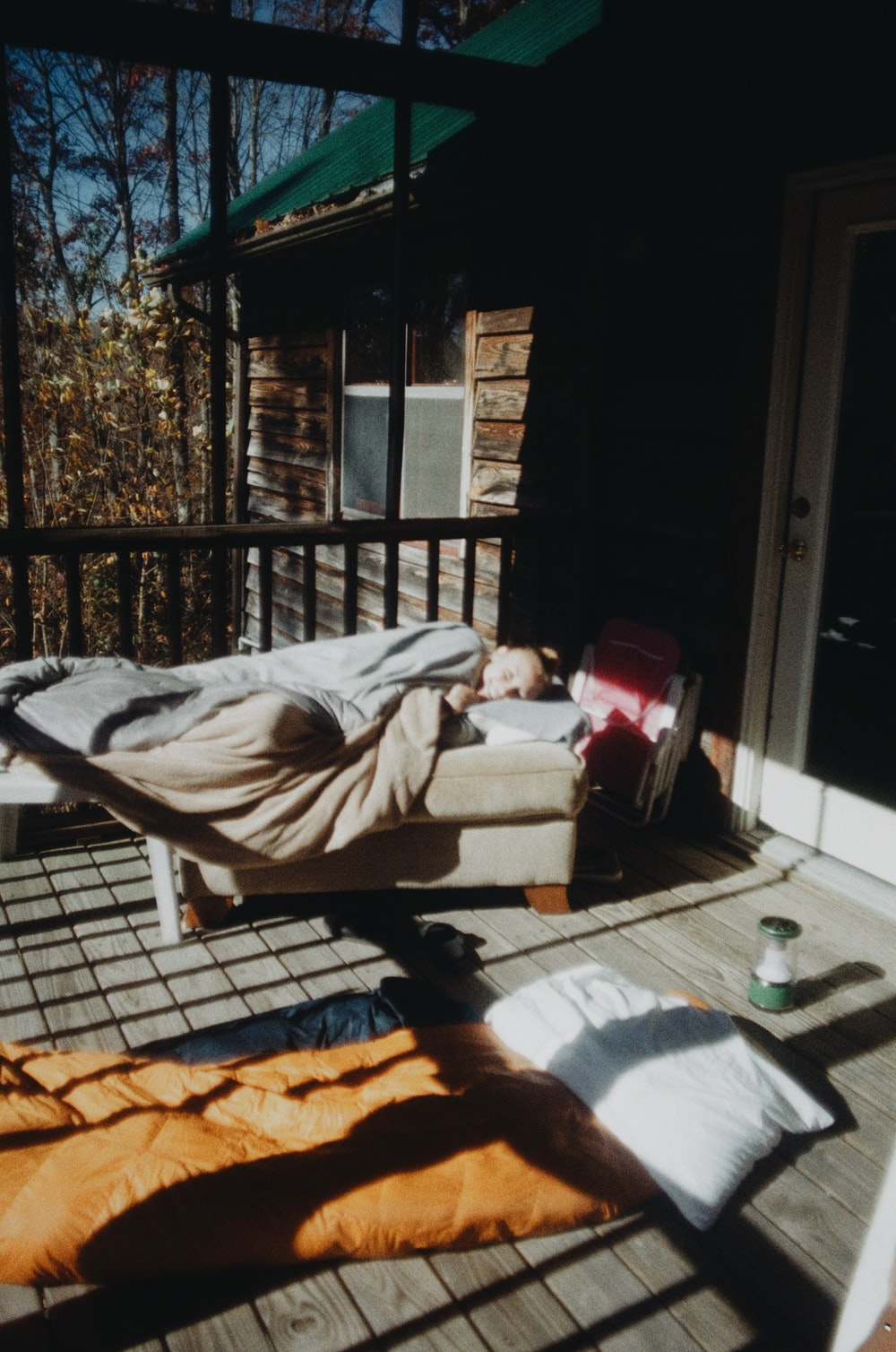 woman lying on brown wooden bench