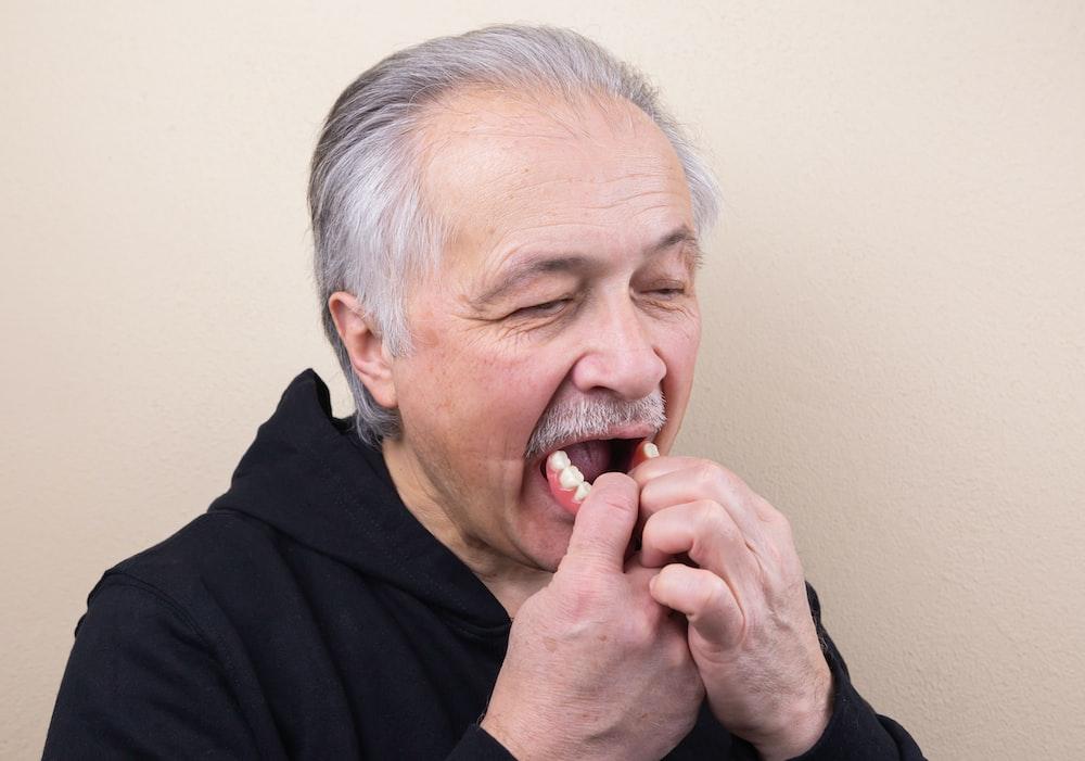 man in black hoodie smoking