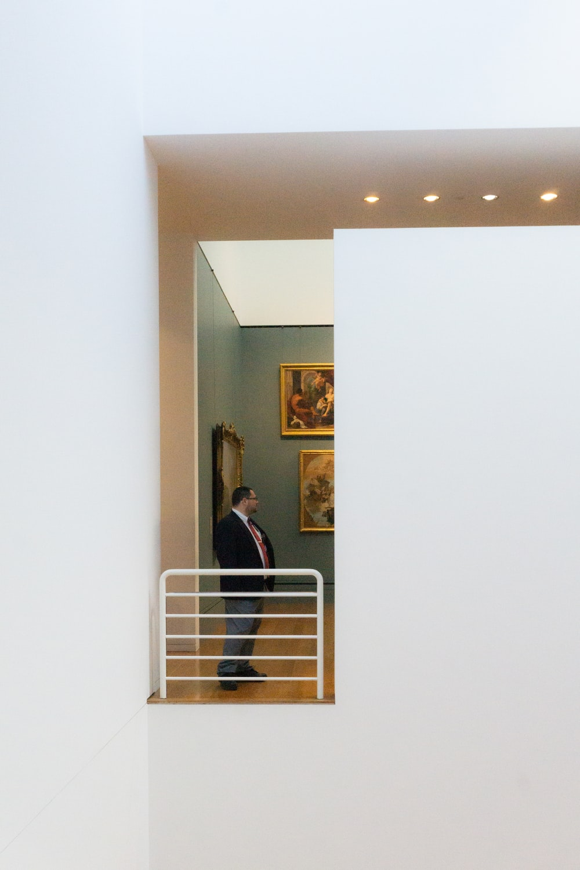 woman in black long sleeve shirt standing near white wall