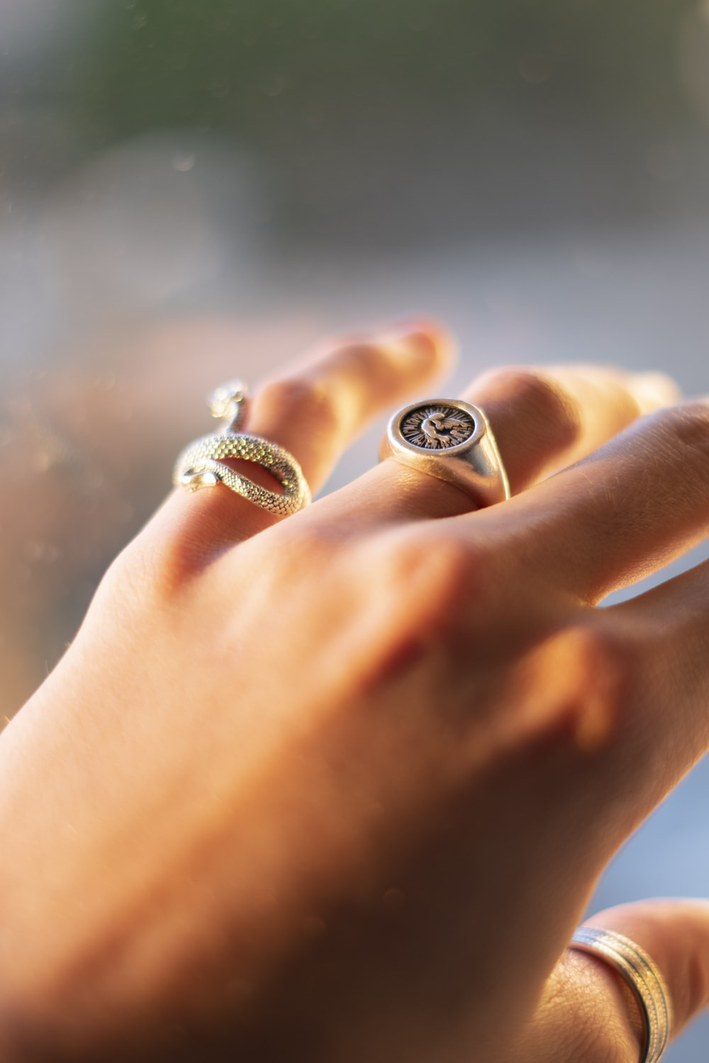 silver diamond ring on persons finger