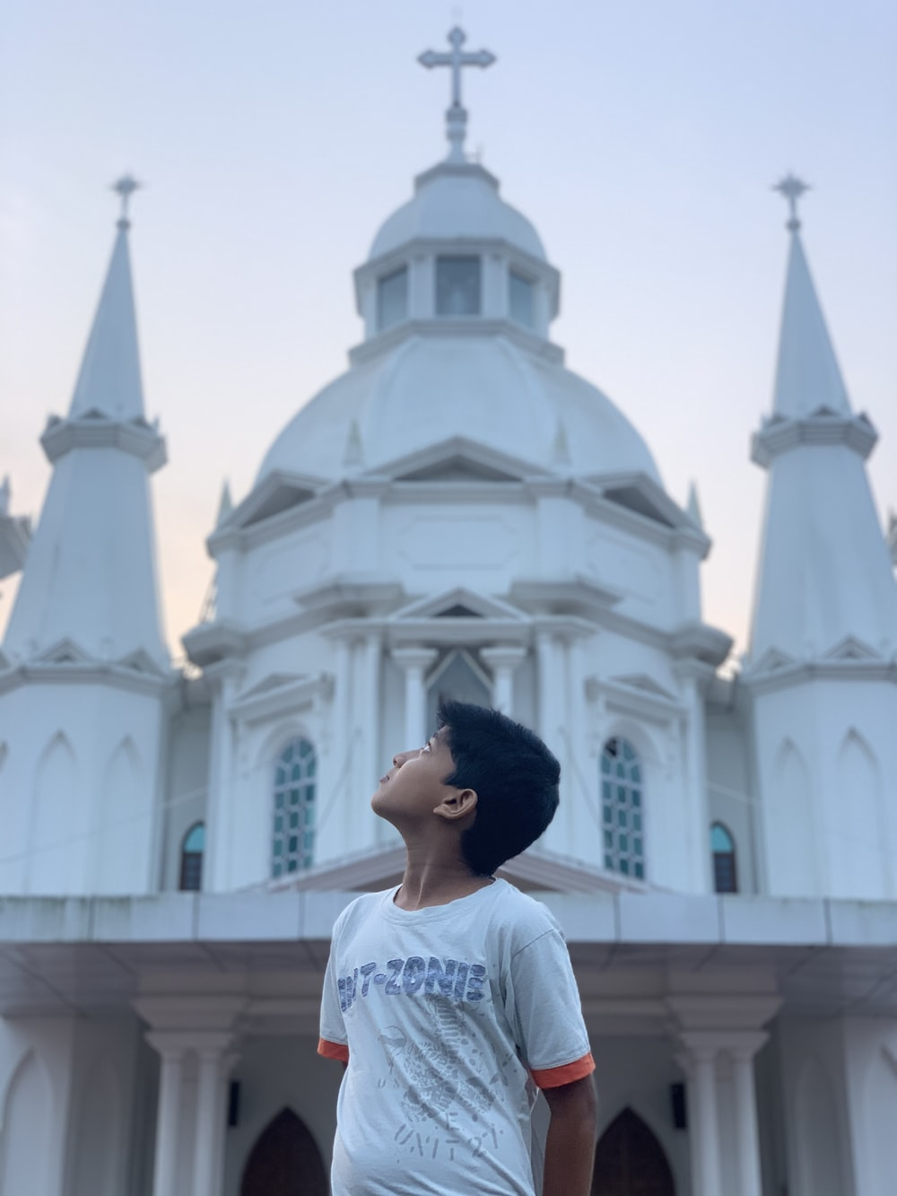 woman in white shirt standing near white cathedral