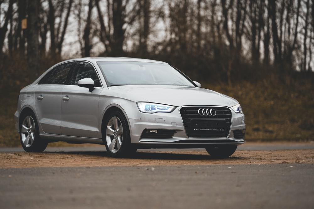 gray audi a 4 coupe on road during daytime