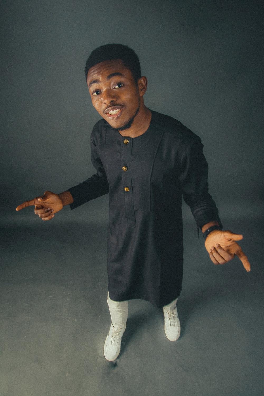 man in black button up long sleeve shirt