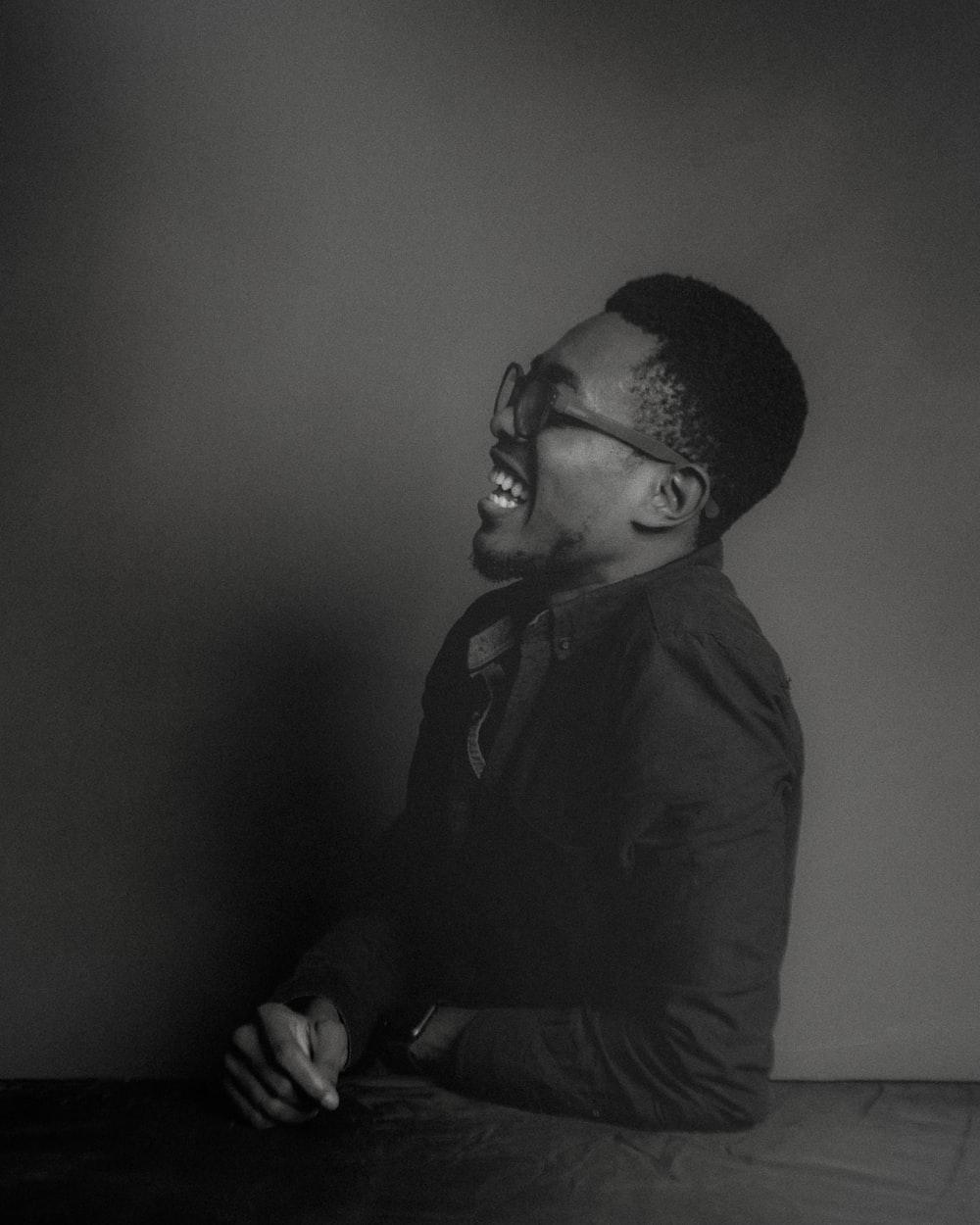 man in black jacket and black framed eyeglasses