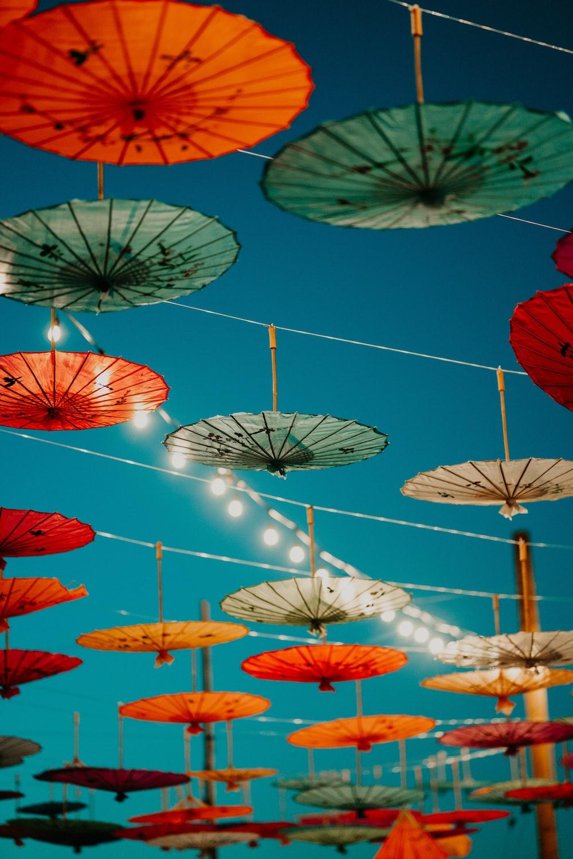 red and white umbrella umbrellas during daytime