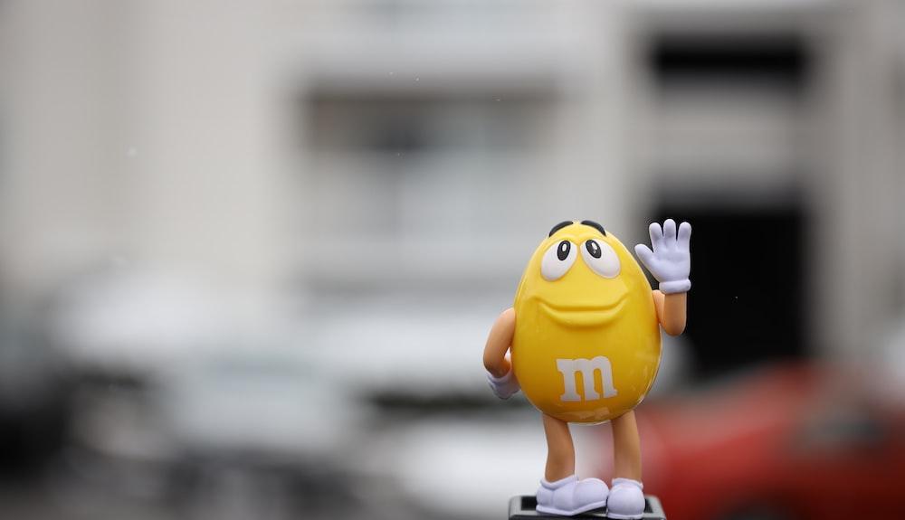 yellow m ms figurine