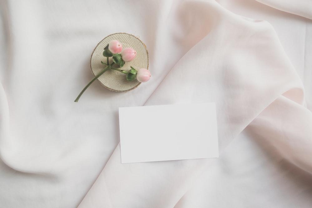 white paper on white textile