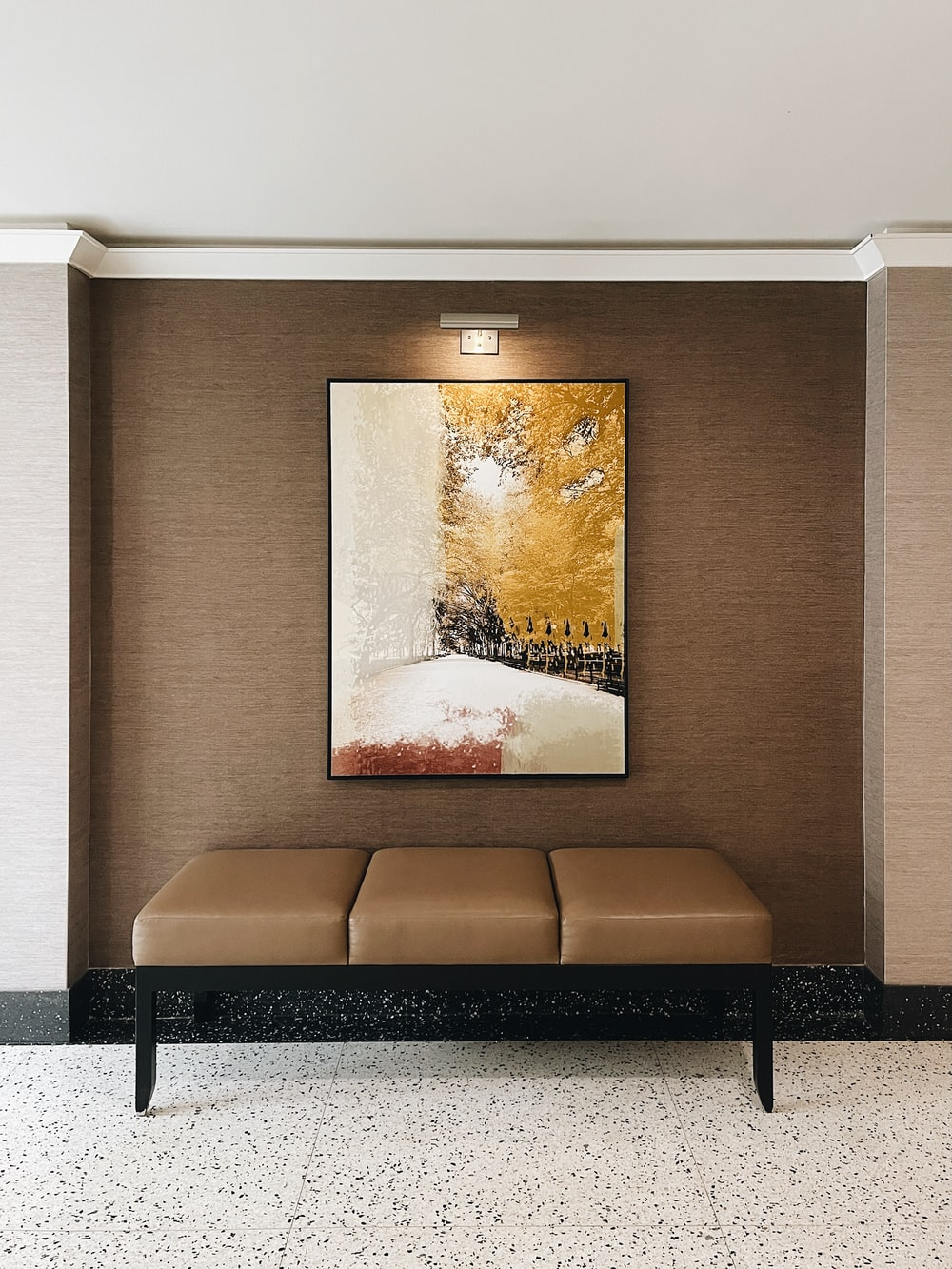 brown wooden framed painting on white wall