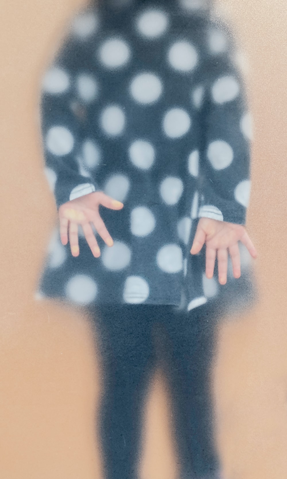 woman in blue and white polka dot long sleeve shirt