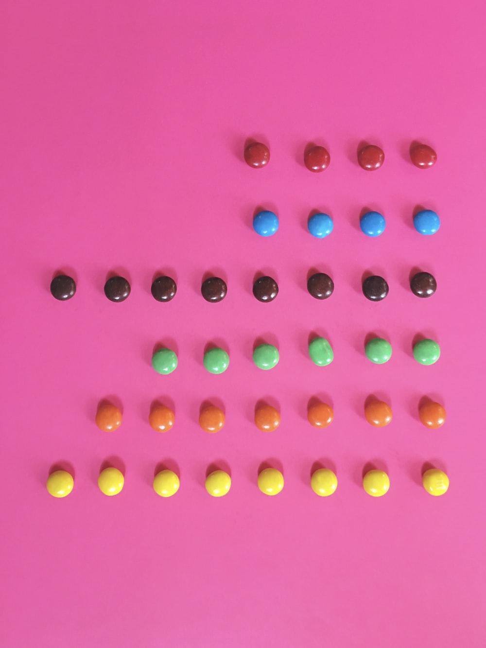 pink and yellow round beads