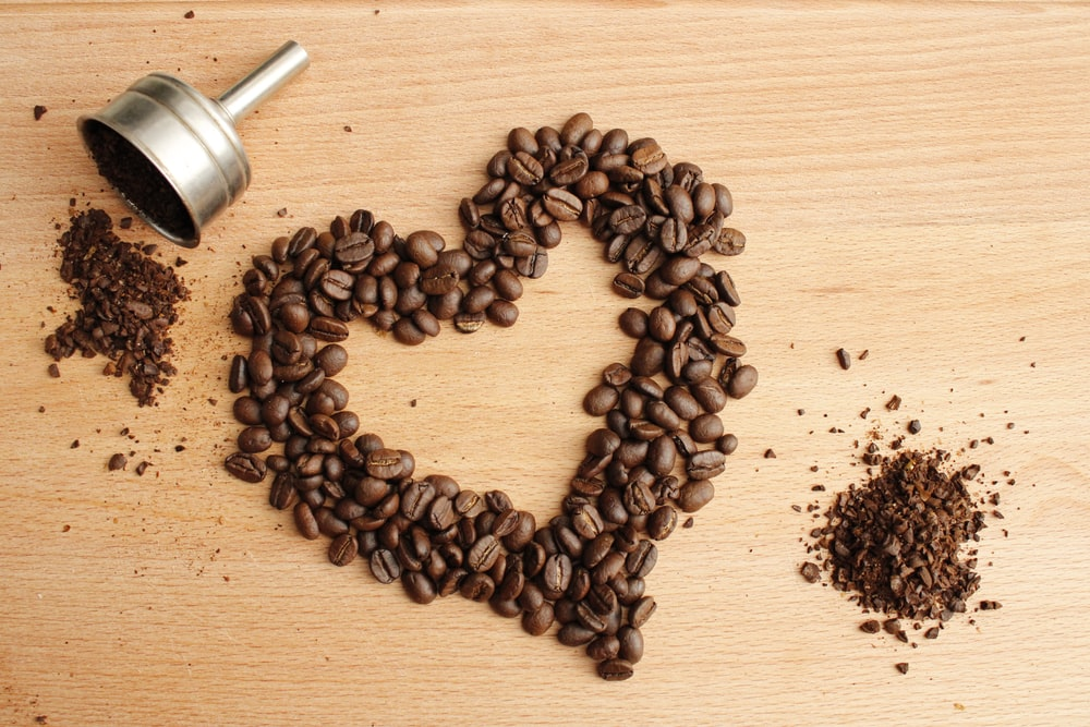 black coffee beans on brown wooden table