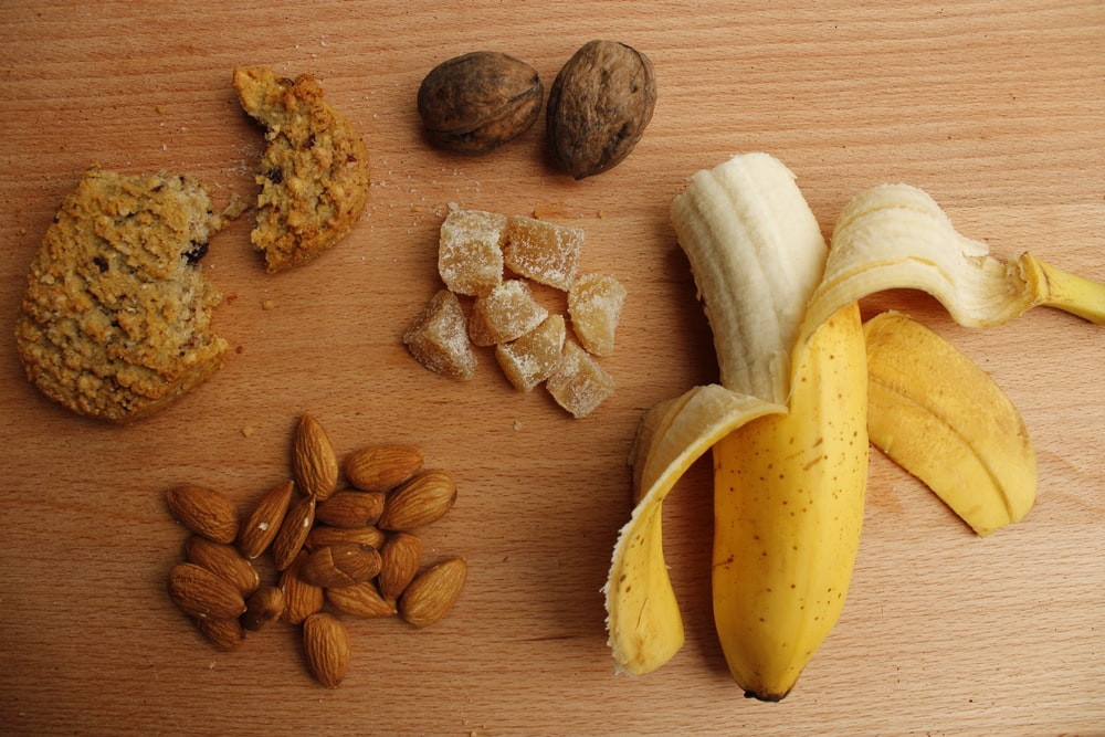 sliced banana and brown nuts on brown wooden table